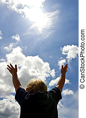 Fun in the Sun - A young boy, with outstretched arms trying...