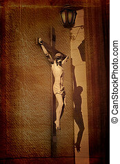 Crucifix - Sculpture of Jesus on the cross, with shadow on...