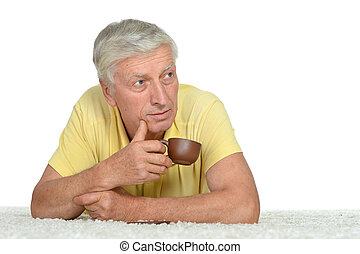 Old man with cup