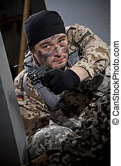 Soldier with handgun aiming