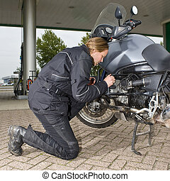 Checking the oil level - A motorist checking the oil level...