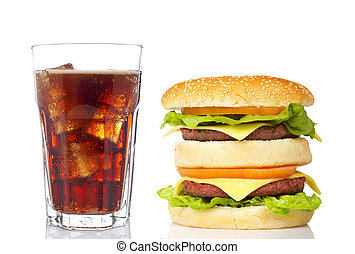 Double cheeseburger and soda glass, reflected on white...