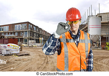 Saluting construction worker - A friendly looking...
