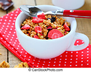 Breakfast cereal with dried fruits, food closeup