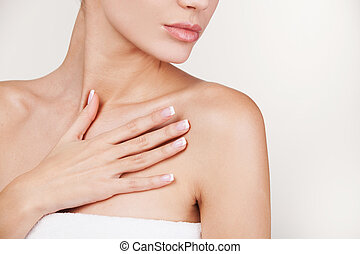 Skin care Cropped image of beautiful young woman wrapped in...