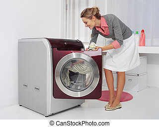 young woman doing laundry - Housework, young woman doing...
