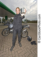Motorcyclist showing a blank steel can