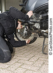 checking the oil level of a motorcycle - A motorcyclist...