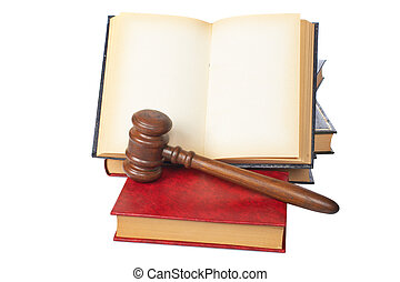 Wooden gavel and old opened law book - Wooden gavel from the...