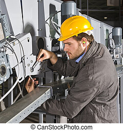 Maintenance engineer at work - A male maintenance engineer...