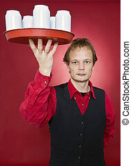Waiter - A waiter holding a tray with five blank cans above...