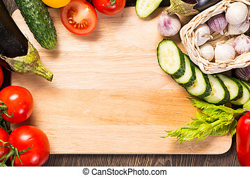 vegetables on the kitchen board - tomatoes, cucumber,...
