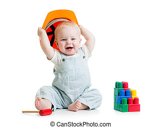 child with hard hat and building blocks