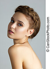 Young beautiful spa woman looking looking straight to camera