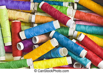 sewing threads - random background or texture of brightly...