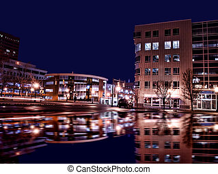 syracuse new york at night - offices and businesses on...