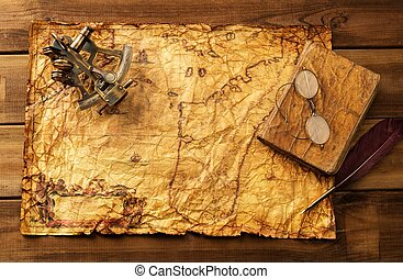 Sextant, old book and glasses on vintage map over wooden...