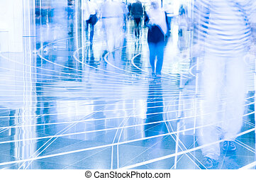 motion blurred of people walking in shopping mall