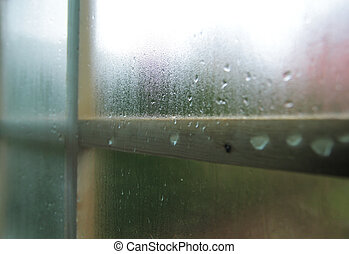 Condensation and raindrops on a window.