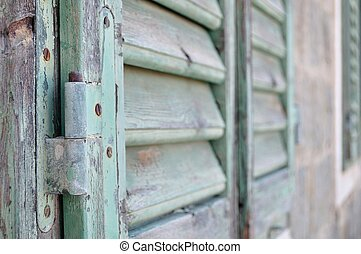 Detail of closed old wooden shutter - Detail of closed green...
