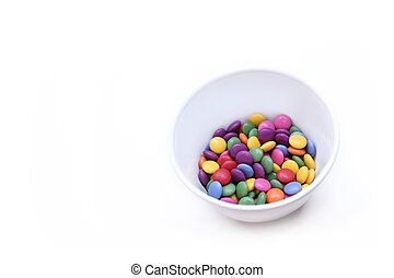 White background with colorful bright candy in bowl