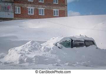 Car stuck in heavy snowbank in the winter