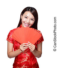 happy chinese new year. smiling asian woman holding red...
