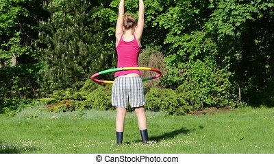 body train garden woman - woman turn spin hula hoop colorful...