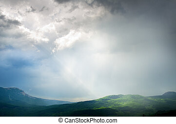 Changeable weather in mountains. Spring nature composition.