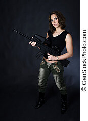 Paintball girl - beautiful young woman in a army outfit and...