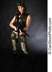 Paintball woman - beautiful young woman in a army outfit and...