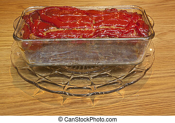 Meatloaf served in a glass casserole dish.