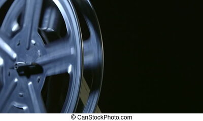 Spinning film reel of movie projector closeup