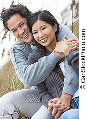 Asian Man Woman Romantic Couple on Beach Dunes - Young Asian...