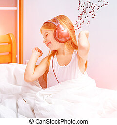 little girl listening to music - little cute girl listening...