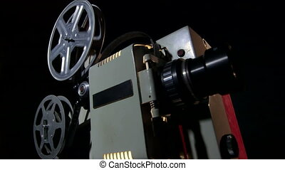 Old movie projector - Old 16 mm movie projector in action...