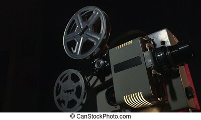 Film projector - Vintage 16 mm movie projector showing film,...