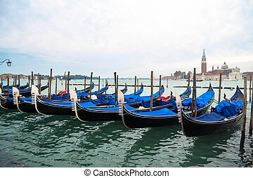 A Row of Gondolas in Venice Italy - A row of gondolas moored...