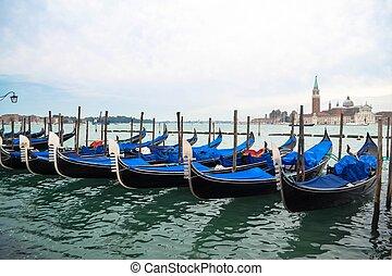 A Row of Gondolas in Venice Italy - A row of gondolas moored...