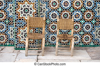 Two chairs on tiles background - Two chairs and zellij...