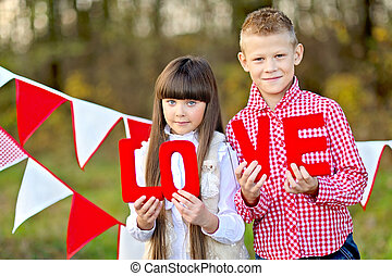 portrait of little boy and girl with decor style Valentines...