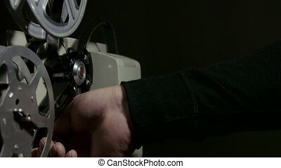 Screening movies on an old film projector - Projectionist...