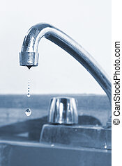 Dripping Faucet - A kitchen faucet thats dripping water.