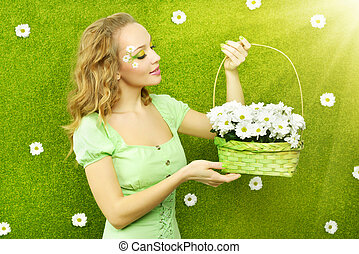 Smiling girl with basket of flowers