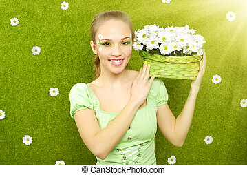 Smiling girl with a basket of flowers