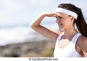 attractive fitness woman looking into distance