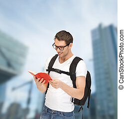 student in eyeglasses with backpack and book - tourism,...