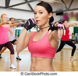 woman with whistle in gym - fitness, sport, training, gym...