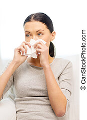 sick girl with paper tissue - healthcare, medicine and home...