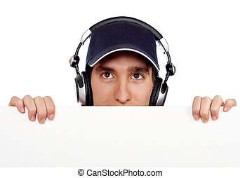 Curious handsome disc jockey - Handsome disc jockey behind...